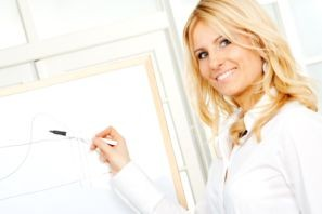 Closeup of young attractive business woman showing